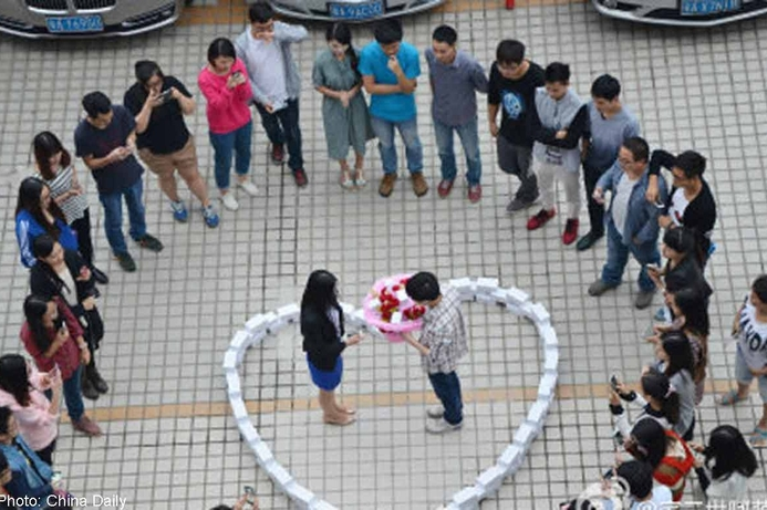 iHeart U: Man proposes with 99 iPhones and she still says 'No'!