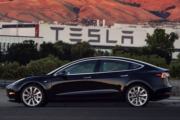 First batch of customers receive the Tesla Model 3